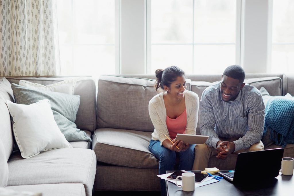 decorative photo - man and woman going over finances